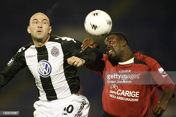 Livorno's defender Kuffour Samuel right and Partizan Mirosavljevic Nenad left from Serbia battle for the ball during a Uefa Cup Group A match between...