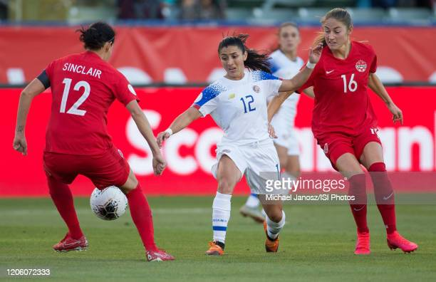 Lixy Rodriguez of Costa Rica attempts to move past Christine Sinclair of Canada during a game between Canada and Costa Rica at Dignity Health Sports...