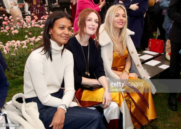 Liya Kebede Julianne Moore and Sienna Miller attend the Tory Burch Fall Winter 2018 Fashion Show during New York Fashion Week at Bridge Market on...