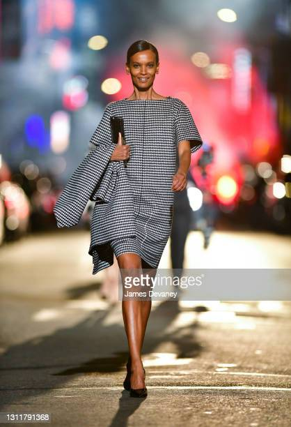 Liya Kebede walks along 46th Street during the Michael Kors Fashion Show in Times Square on April 08, 2021 in New York City.