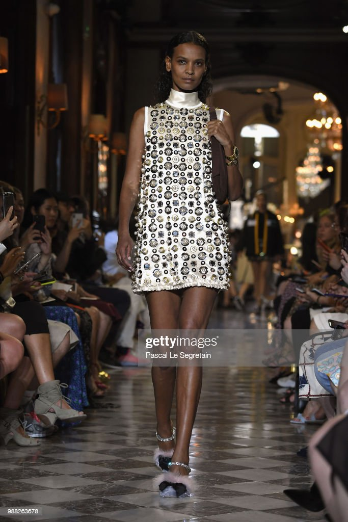 liya-kebede-walks-the-runway-during-miu-miu-2019-cruise-collection-picture-id988263678