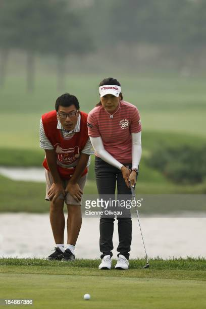 Liying Ye of China prepares a putt during the second round of the Reignwood LPGA Classic at Pine Valley Golf Club on October 4 2013 in Beijing China