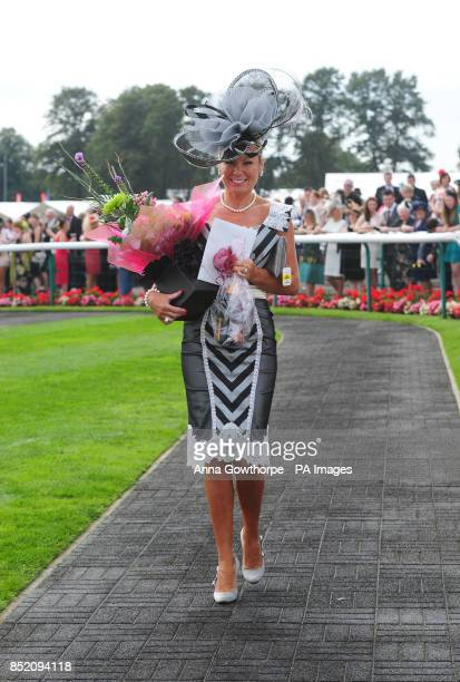 Liz Akroyd from Hull wins first prize for Best Dressed Lady during DFS Ladies Day at the Ladbrokes St Leger Festival at Doncaster Racecourse.