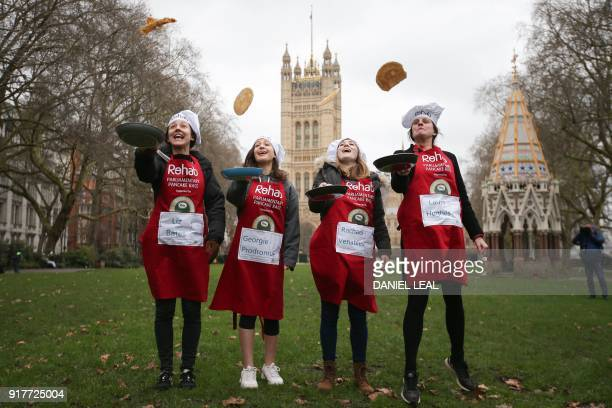 Liz Bates Georgie Prodromue Rachael Venables and Laura Hugues from the media team toss pancakes in front on the Houses of Parliament at the annual...