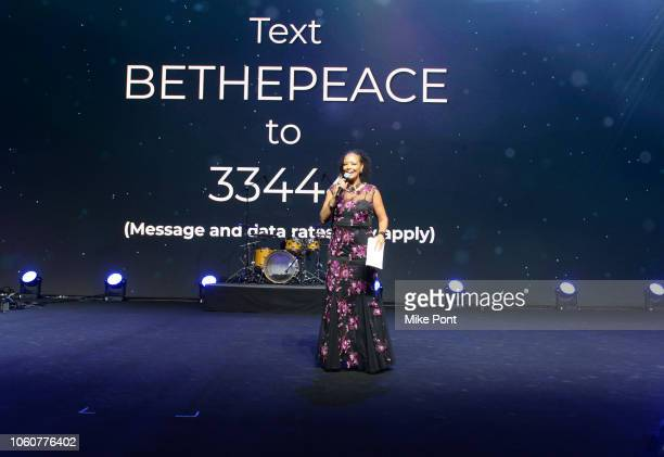 Liz Black appears on stage during Peace Starts With Me concert at Nassau Coliseum on November 12 2018 in Uniondale New York
