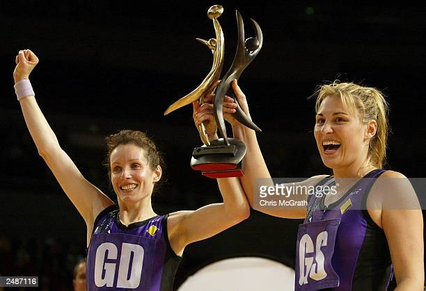 Liz Boniello and Eloise Sothby raise the Comonwealth Bank Trophy after defeating the Swifts during the 2003 Comonwealth Bank Trophy Grand Final...