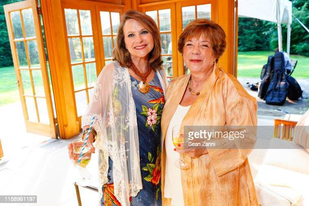 Liz Boylan and Karen Lund attend A Country House Gathering To Benefit Preservation Long Island on June 28 2019 in Locust Valley New York