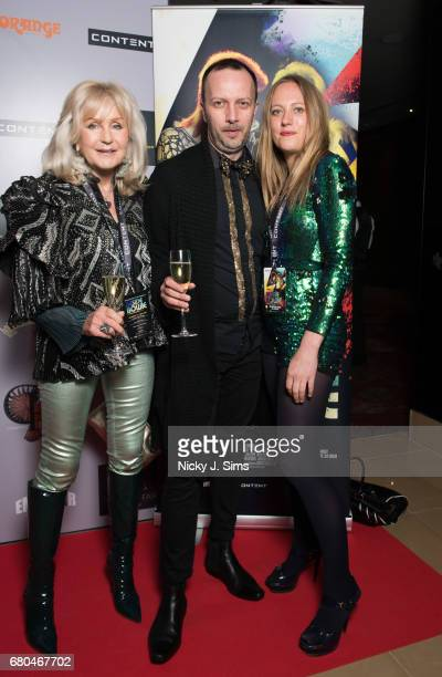 Liz Brewer Deltcho Deltchev and Tallulah Rendall attend the UK Premiere of Jon Brewer's 'BESIDE BOWIE The Mick Ronson Story' at The Mayfair Hotel on...