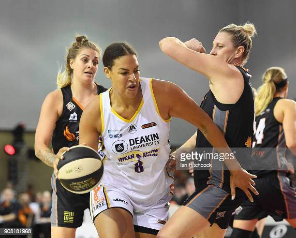 Liz Cabbage of the Boomers drives to the basket past Suzy Batkovic of the Fire during game three of the WNBL Grand Final series between the...