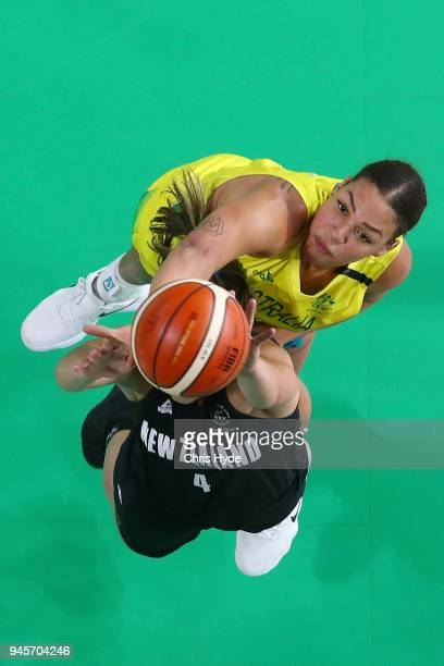 Liz Cambage of Australia and Kalani Puurcell of New Zealand compete for the ball during the Women's Semifinal Basketball match between Australia and...