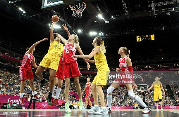 Liz Cambage of Australia attempts a shot against Nadezhda Grishaeva and Evgeniya Belyakova of Russia during the Women's Basketball Bronze Medal game...