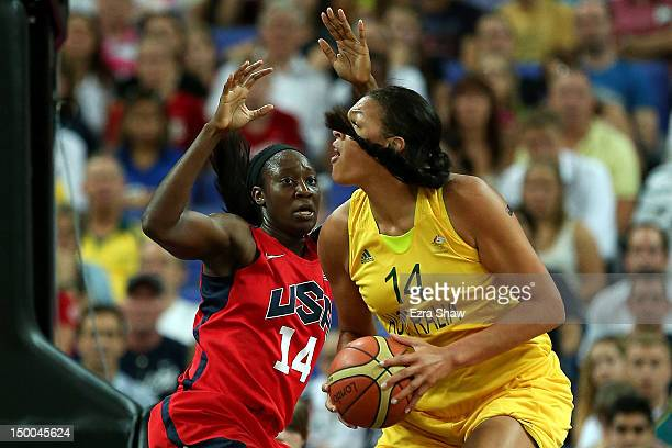 Liz Cambage of Australia looks to move the ball in the post in the first half against Tina Charles of United States during the Women's Basketball...