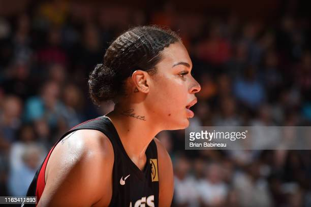 Liz Cambage of the Las Vegas Aces looks on during the game against the Connecticut Sun on August 23 2019 at the Mohegan Sun Arena in Uncasville...