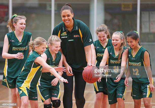Liz Cambage plays basketball with girls from the Dandenong Rangers during a Dandenong Basketball Association announcement at Melbourne Sports and...
