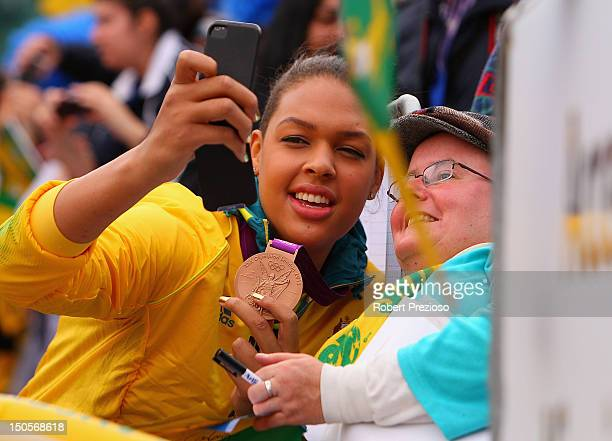 Liz Cambage poses with a fan during the Australian Olympic Team Homecoming Parade at Federation Square on August 22 2012 in Melbourne Australia