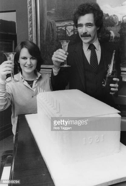 Liz Carle and David Battie director of Sotheby's Belgravia celebrate the auction house's tenth anniversary with a twofoot high cake in the shape of...