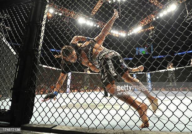 Liz Carmouche slams Jessica Andrade during their bantamweight bout during the UFC on FOX event at Key Arena on July 27 2013 in Seattle Washington
