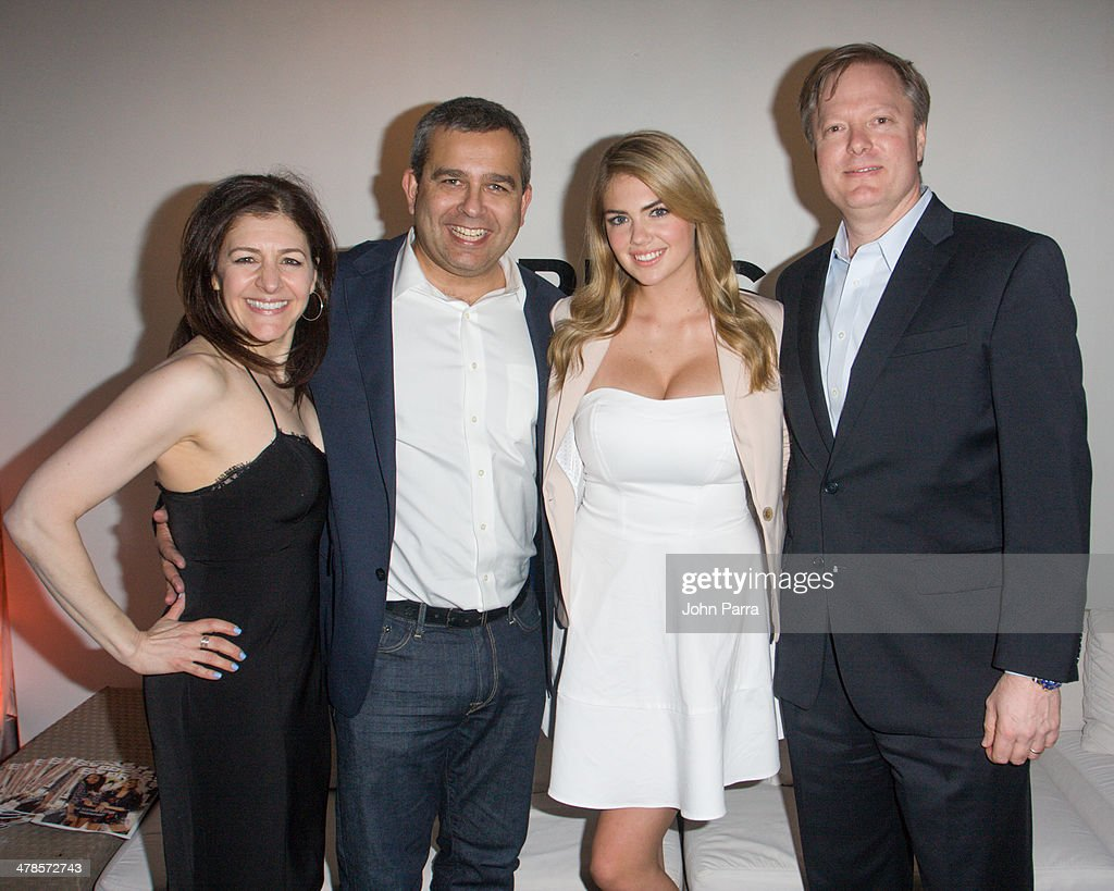 Liz Crystal, David Kornberg, Kate Upton and Matt Moellering attend the EXPRESS South Beach at The Raleigh Hotel on March 13, 2014 in Miami, Florida.