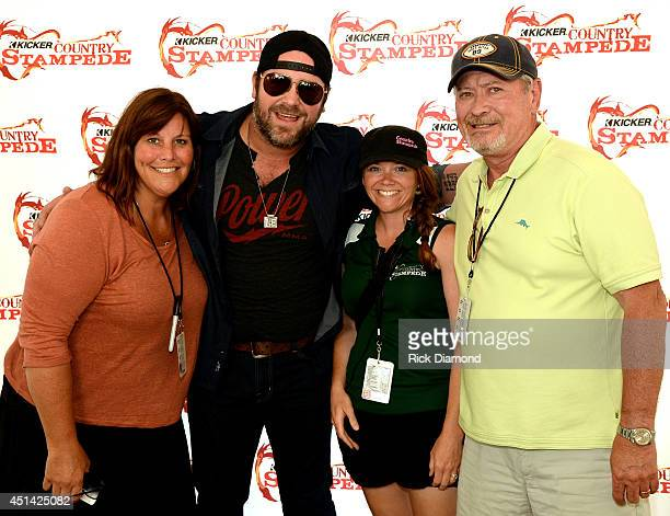 Liz Cunningham Adrienne Hayes and Gil Cunningham Neste Event Marketing with Singer/Songwriter Lee Brice backstage during 'Kicker Country Stampede' at...