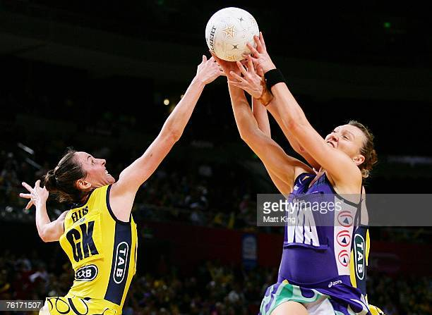 Liz Ellis of the Swifts and Wendy Jacobsen of the Phoenix compete for the ball during the Commonwealth Bank Trophy Final match between the Melbourne...