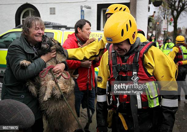 Liz Fitton is reunited with her dog Molly after being rescued by an RSPCA rescue team on November 21 2009 in Cockermouth United Kingdom A major...