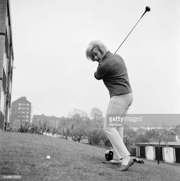 Liz Fraser English actress practices her golf swing April 1967
