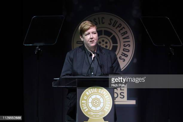 Liz Gallacher speaks onstage during the 9th Annual Guild of Music Supervisors Awards on February 13 2019 at The Theatre at Ace Hotel in Los Angeles...