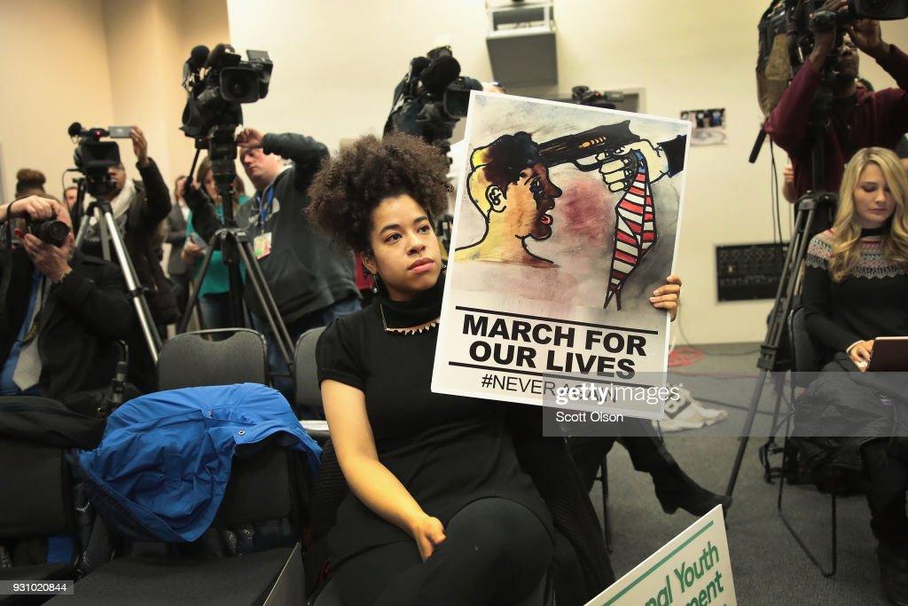 Liz Gomez listens as Mayor Rahm Emanuel hosts a press