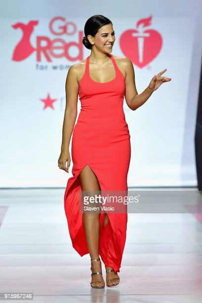 Liz Hernandez walks the runway during the American Heart Association's Go Red For Women Red Dress Collection 2018 presented by Macy's at Hammerstein...