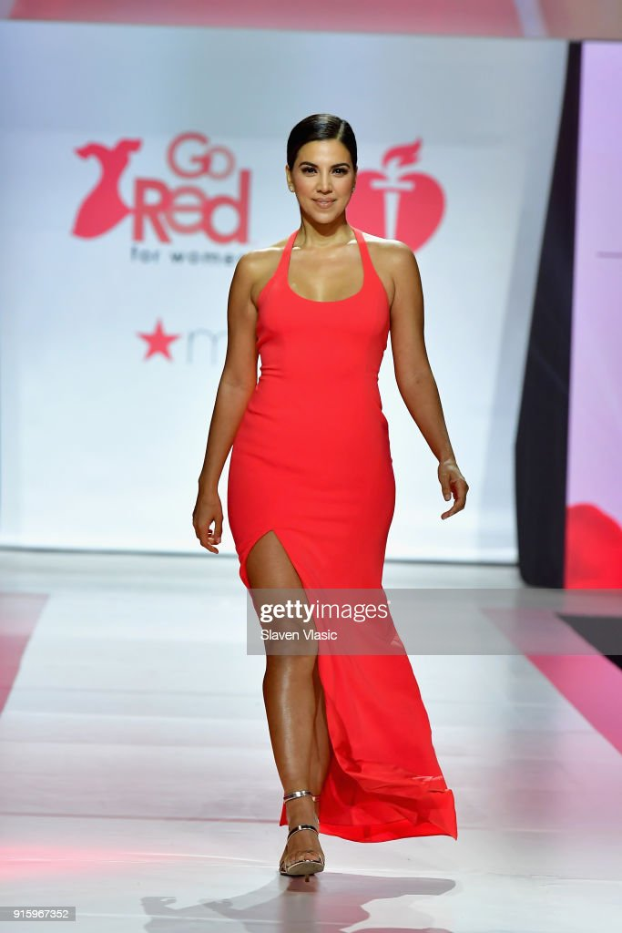 Liz Hernandez walks the runway during the American Heart Association's Go Red For Women Red Dress Collection 2018 presented by Macy's at Hammerstein Ballroom on February 8, 2018 in New York City.