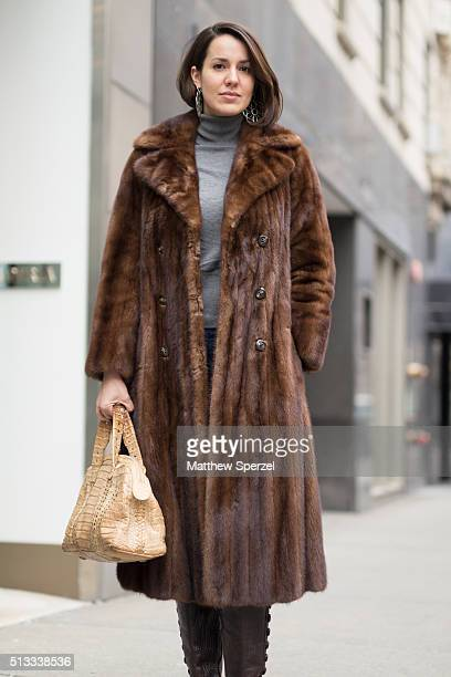 Liz Hopkins is seen on Oak Street wearing a vintage golden brown mink coat vintage black leather boots and light tan alligator bag and homemade...