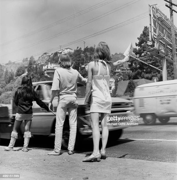 Liz Hudson sells newspaper on the Sunset Strip in Los Angeles, California.