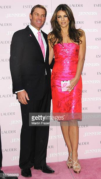 Liz Hurley accomplied by Shane Warne switch on the lights and illuminate Jenners department store in pink for Estee Lauder Companies' Breast Cancer...