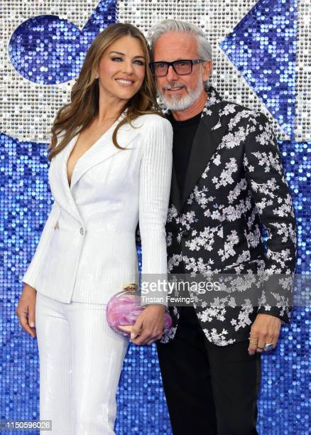 Liz Hurley and Patrick Cox attend the Rocketman UK premiere at Odeon Luxe Leicester Square on May 20 2019 in London England