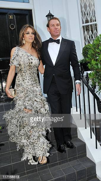 Liz Hurley and Shane Warne leave for Elton John's White Tie and Tiara party on June 23 2011 in London England