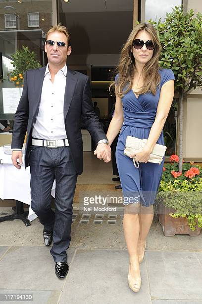 Liz Hurley and Shane Warne sighted leaving a restaurant on Fulham road on June 24 2011 in London England