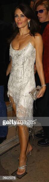 Liz Hurley arrives at a party for Fashion Rocks at the Kensington Roof Gardens October 15 2003 in London England