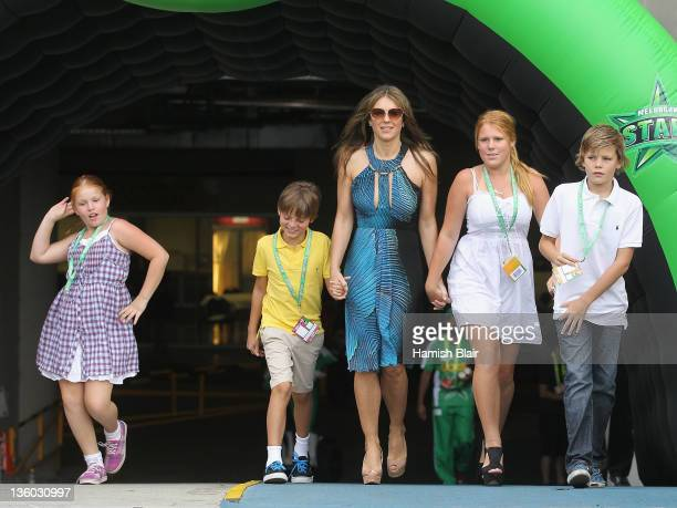 Liz Hurley walks out to toss the coin with her son Damian and Shane Warne's children Brooke Summer and Jackson ahead of the T20 Big Bash League match...