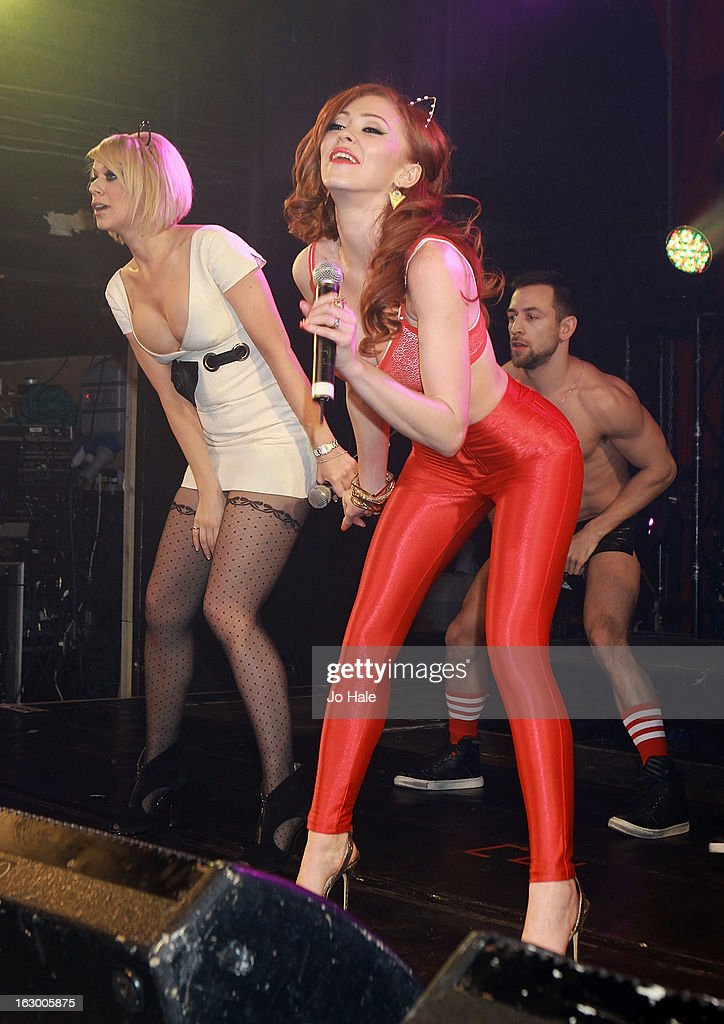 Liz McClarnon and Natasha Hamilton of Atomic Kitten perform on stage at G-A-Y on March 2, 2013 in London, England.