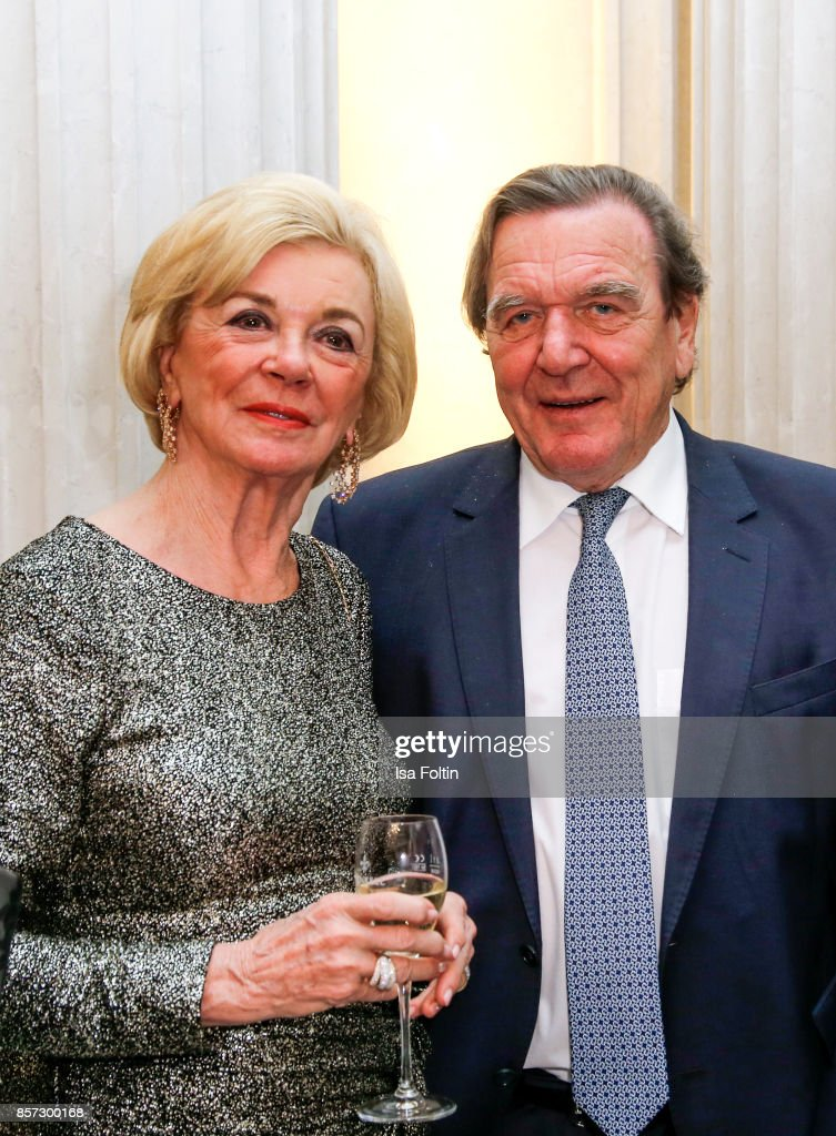 Liz Mohn and former German chancellor Gerhard Schroeder during the Re-Opening of the Staatsoper Unter den Linden (State Opera Berlin) on October 3, 2017 in Berlin, Germany.
