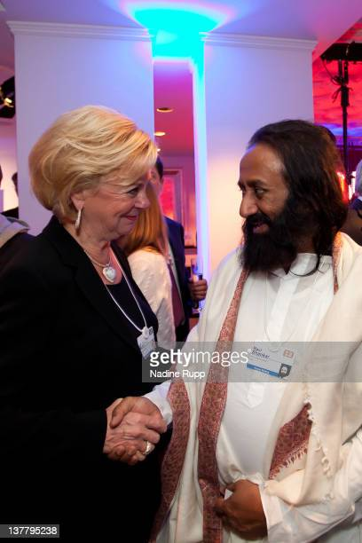 Liz Mohn and Ravi Shankar attend the Burda DLD Nightcap 2011 at the Steigenberger Bellvedere hotel on January 25 2012 in Davos Switzerland DLD is a...