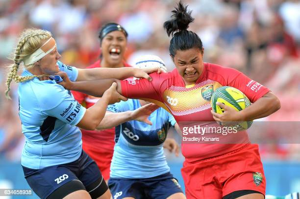 Liz Patu of Queensland takes on the defence during the Rugby Global Tens Women's match between Queensland and New South Wales at Suncorp Stadium on...