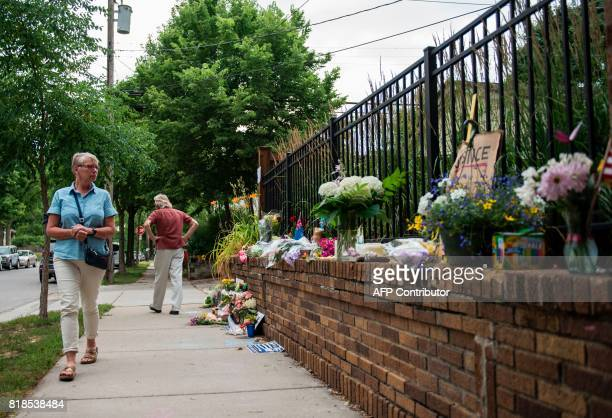 Liz Reyer who attended yoga with Justine Damond walks by a makeshift memorial on July 18 2017 in Minneapolis Minnesota Scrutiny intensified into the...