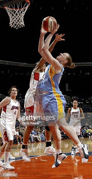 Liz Shimek of the Chicago Sky works to shoots the ball over Allison Feaster of the Charlotte Sting on August 12 2006 at the Charlotte Bobcats Arena...