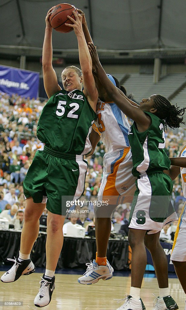Liz Shimek #52 of the Michigan State Spartans grabs a rebound over Shyra Ely #43 of the Tennessee Lady Vols and Victoria Lucas-Perry #31 of the Michigan State Spartans in the Semifinal game of the Women's NCAA Basketball Championship on April 3, 2005 at the RCA Dome in Indianapolis, Indiana.