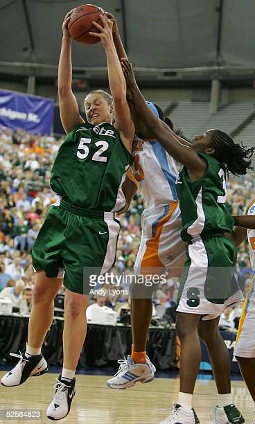 Liz Shimek of the Michigan State Spartans grabs a rebound over Shyra Ely of the Tennessee Lady Vols and Victoria LucasPerry of the Michigan State...