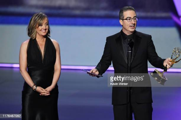 Liz Stanton and John Oliver accept the Outstanding Variety Talk Series award for 'Last Week Tonight with John Oliver' onstage during the 71st Emmy...