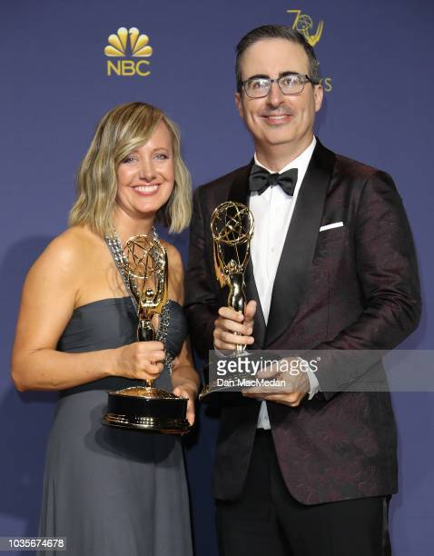 Liz Stanton and John Oliver pose with their Outstanding Variety Talk Series awards for 'Last Week Tonight with John Oliver' in the press room on...