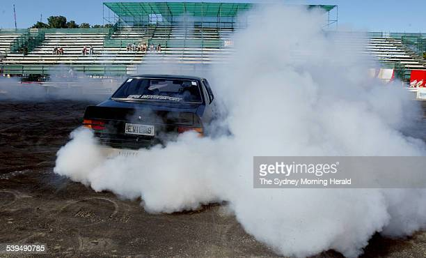Liz Stewart from New Zealand is the New Zealand burnout queen and is at the 18th Summernats held in canberra on 7 January 2005 SMH NEWS Picture by...
