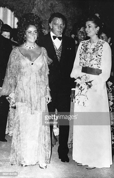 Liz Taylor and her husband Richard Burton meet Princess Grace of Monaco at a Red Cross Gala in Monaco 7th August 1971